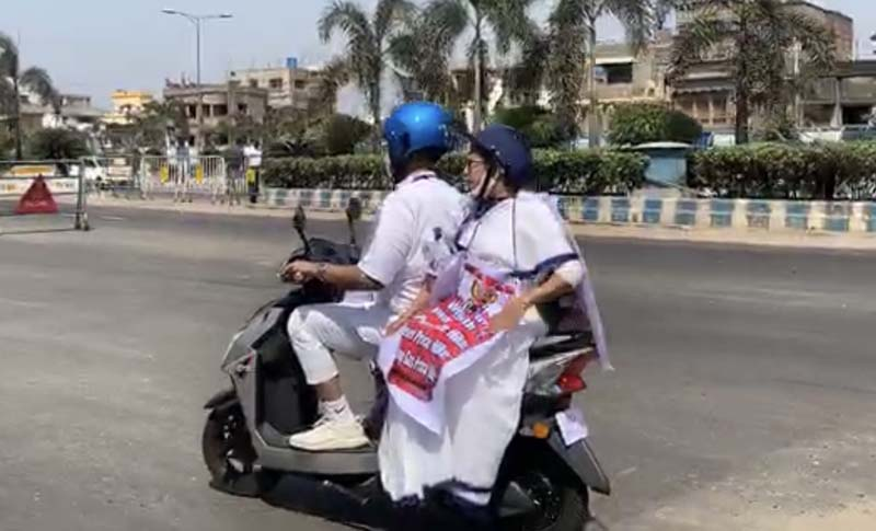 Mamata Banerjee rides electric scooter